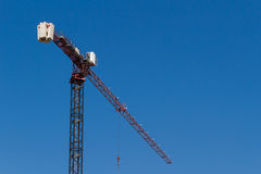 Tower crane on blue sky, Ukraine Stock Images