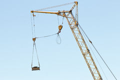 Tower crane boom with load Stock Image