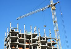 Tower Crane, building construction site with contractor on the Stock Image