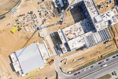 Tower crane and building equipment at construction site. drone image royalty free stock images