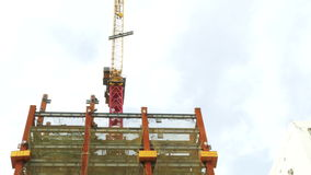 Tower crane on building moving I-beam