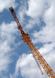 Tower crane in the clouds Royalty Free Stock Photo