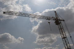 Tower crane in the clouds Royalty Free Stock Photos