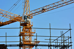 Tower crane in construction. Hardware of tower crane in construction, shown as architecture construction and working environment and equipment Royalty Free Stock Photo