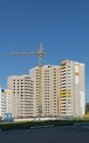 Tower crane on the construction of a new high multistory apartment building Royalty Free Stock Image