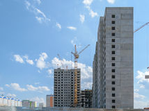 Tower crane on the construction of a new multi-storey house Royalty Free Stock Image