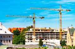 Tower crane, construction of a residential house, a crane against the sky, a counterweight, Industrial skyline stock photo