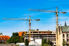 Tower crane, construction of a residential house, a crane against the sky, a counterweight, Industrial skyline royalty free stock image