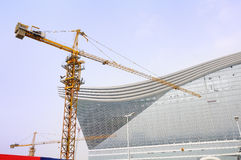 Tower crane on construction site. New Century Global Center,the largest single building in the world,covering an land area of 1300 mus(about 866,667 square Royalty Free Stock Photos