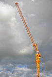 Tower crane. On construction site with cloudy background Royalty Free Stock Photo