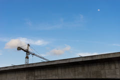 Tower crane on a construction site. With moon Royalty Free Stock Photo