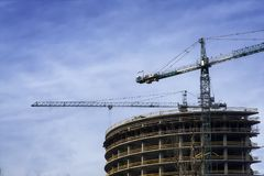 Tower crane at construction site in morning sunlight stock photography