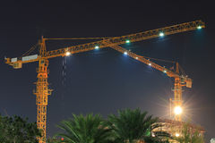 Tower crane in construction site at night Royalty Free Stock Images