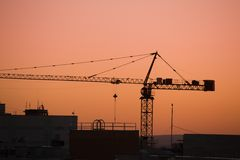 Tower crane on a construction site at sunrise Stock Image