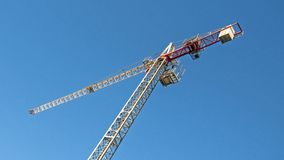 Tower Crane. High above in Blue Sky. Gosford, Australia - November 16. 2017:  43.  Tower Crane erected on a building construction site in Beane St. Gosford, New Stock Images