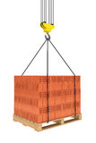 Tower Crane Hook with Stacked Red Bricks over wooden Pallet Stock Photography