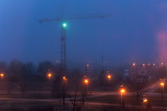 Tower crane and illumination at night, construction site Royalty Free Stock Image
