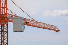 Tower crane industry selective focus construction buildings site city on blue sky. Background Stock Photography