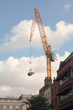 Tower crane. Lifting bucket in London Stock Photography