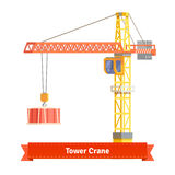 Tower crane lifting building materials on the hook Royalty Free Stock Image