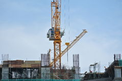 Tower Crane lifting heavy load Stock Photos