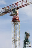 Tower crane machine, operators cab and load concrete weights Stock Photo