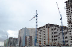 Tower crane and multi-storey building. Tower crane and multi-storey build Stock Image