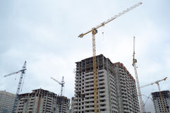 Tower crane and multi-storey building Stock Photography