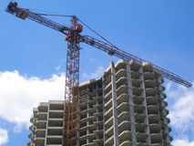 Tower crane and a newly erected building. Stock Photo