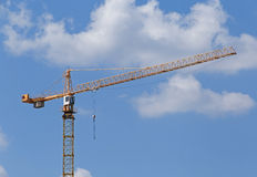 Tower crane. Over blue sky with clouds Royalty Free Stock Image