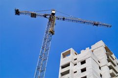 Tower crane over building. Tower crane Royalty Free Stock Photography