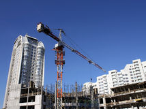 Tower crane over concrete frame of building construction Royalty Free Stock Images