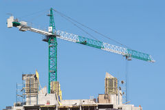Tower crane over construction building top Royalty Free Stock Photos