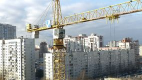 Tower crane over a construction site time lapse, zoom out