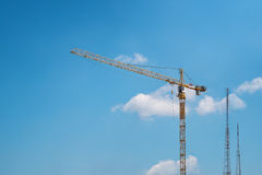 Tower crane and radio towers Stock Photo