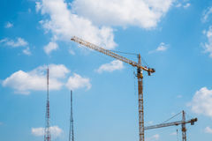 Tower crane and radio towers. Telephone towers Stock Photography