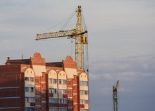 Tower crane and reinforced building under construction Royalty Free Stock Photo