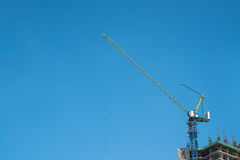 Tower crane. And reinforced building under construction Stock Photos