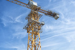 Tower crane shot against a blue sky.  Royalty Free Stock Image