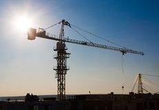 Tower crane silhouette at construction area Stock Images
