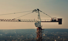 Tower crane silhouette at construction area Royalty Free Stock Photography