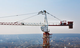 Tower crane silhouette at construction area Stock Photo