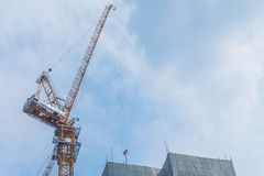 Tower crane with sky, Yellow high construction crane building. stock image