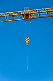 Tower crane with steel hook. On blue background Royalty Free Stock Photography