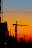 Tower crane and sunset Royalty Free Stock Photography