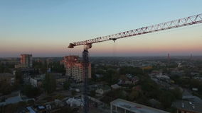 Tower crane at sunset. Departure quadrocopters stock footage