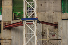 Tower crane support with the lift wall during work for high-rise Royalty Free Stock Photo