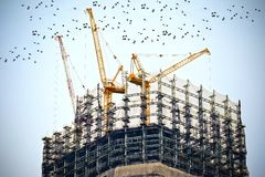 Tower Crane on Top of Building Stock Image