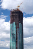 Tower crane on top of construction building Stock Photos