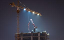 Tower Crane On Top Of A Skyscraper In The Night Stock Photos